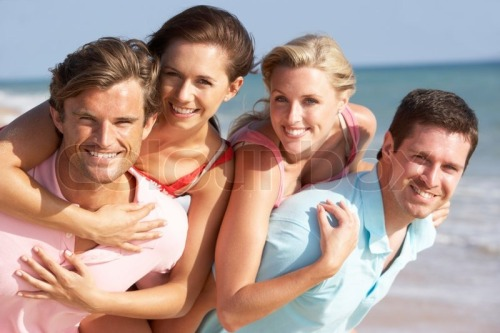 1268947-group-of-friends-enjoying-beach-holiday.jpg